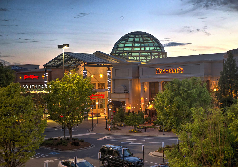 SouthPark is an upscale shopping mall named after the affluent SouthPark neighborhood the mall is located in. The mall is located approximately five miles (8 km) south of Uptown Charlotte, North Carolina at the corner of Sharon and Fairview Roads.